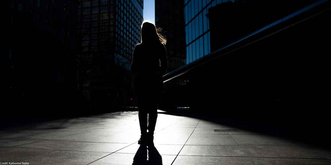 Silhouette of Farah, one of the woman in this blog, standing in front of skyscrapers