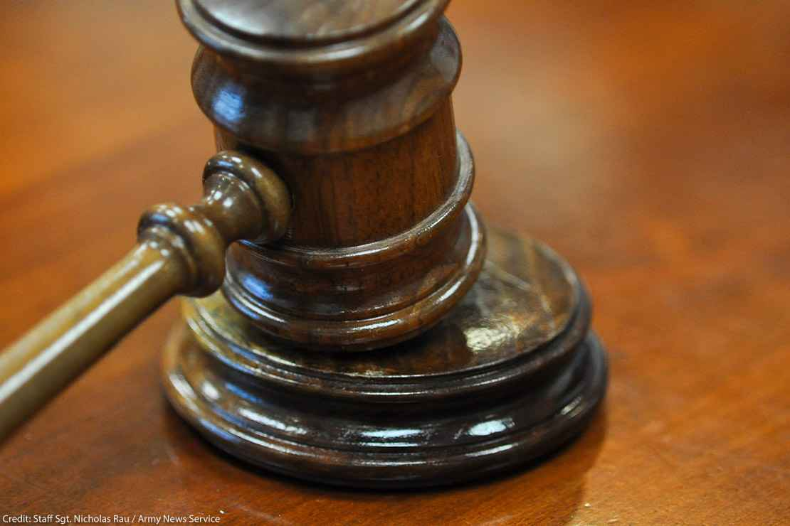 Photo of gavel on judge's bench.