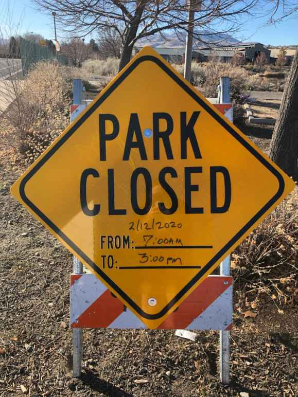Sign announces park closure for Reno sweeps