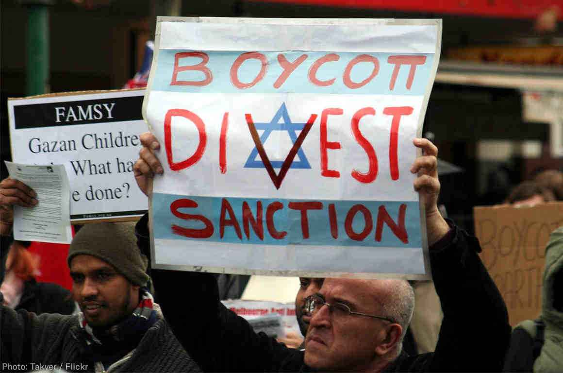 boycott divest sanction sign