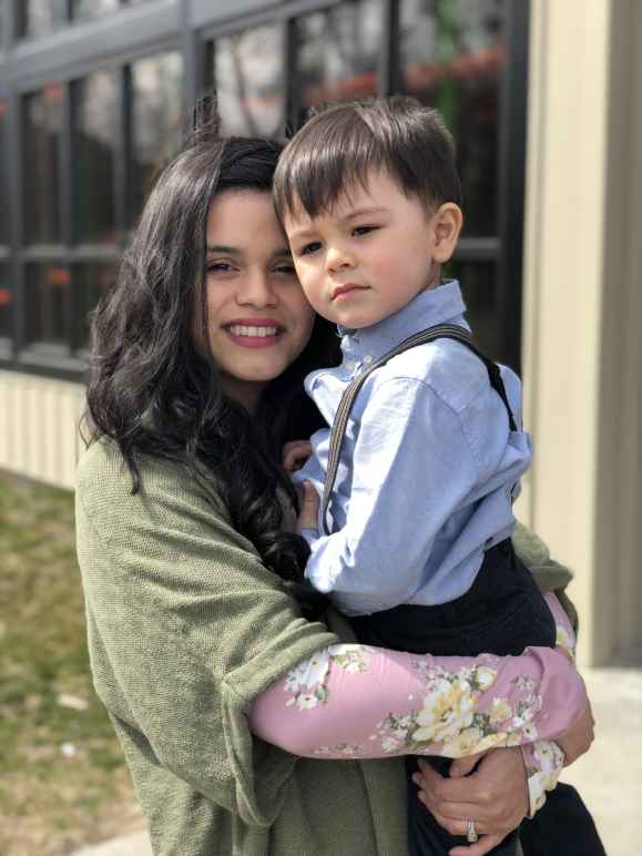Plaintiff Katia Hills holds her son.