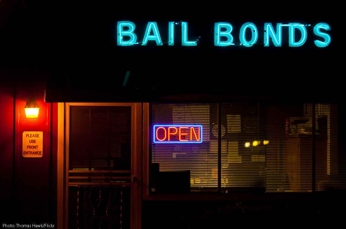 Neon bail bonds sign outside building